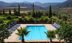 Kasbah Angour's gardens and pool with views to the Atlas mountains