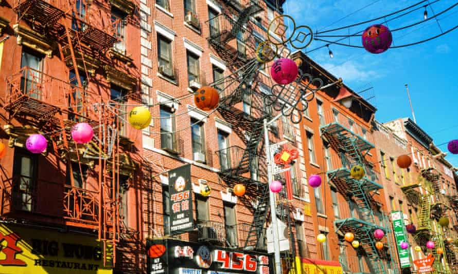 The installation of fuchsia, gold and flame-coloured lanterns on Mott Street.