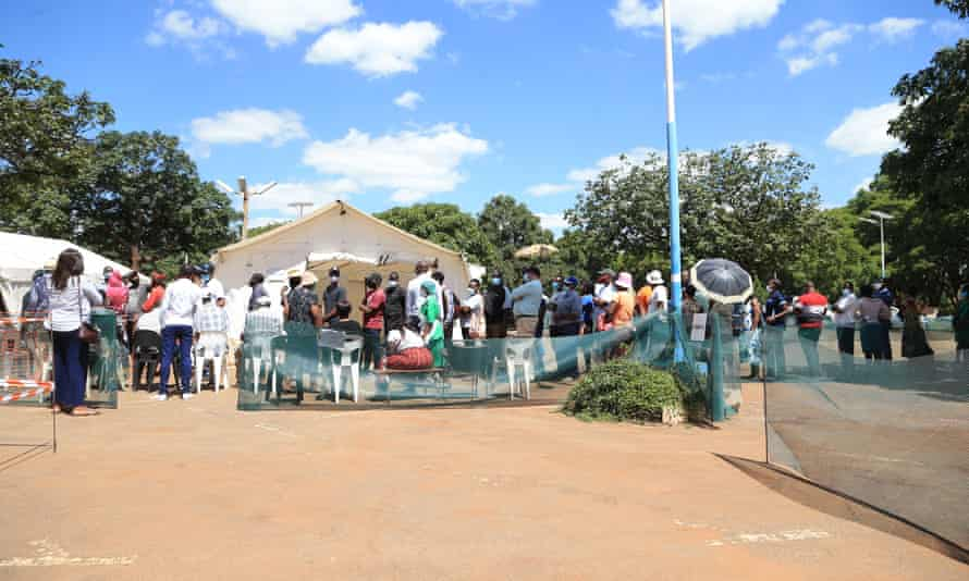 People queue to receive a coronavirus vaccine at Parirenyatwa Hospital on 31 March.
