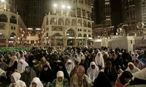 Pilgrims pray outside the Grand Mosque in the Mecca