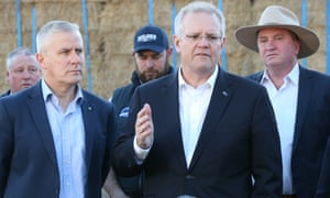 Scott Morrison with drought envoy Barnaby Joyce, Deputy PM Michael McCormack and truck driver Jeremy Taylor during a visit to the property of Vern Drew at Royalla outside Canberra