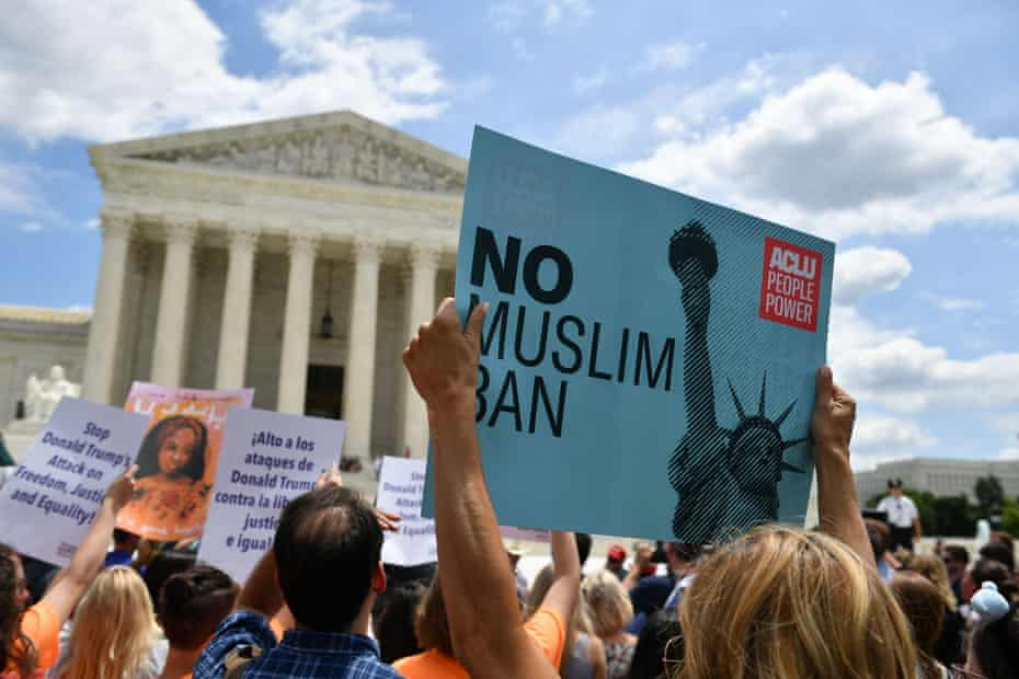 People protest Trump's travel ban outside of the US Supreme Court in Washington, DC in 2018.