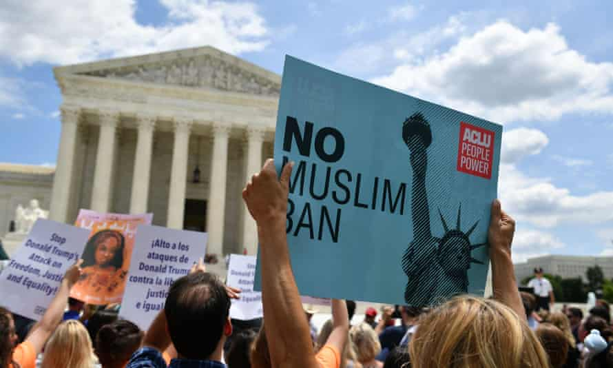 People protest the Muslim travel ban outside of the US supreme court in Washington DC on 26 June 2018.