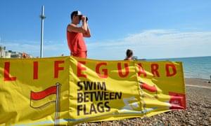 A lifeguard on duty on Brighton beach.