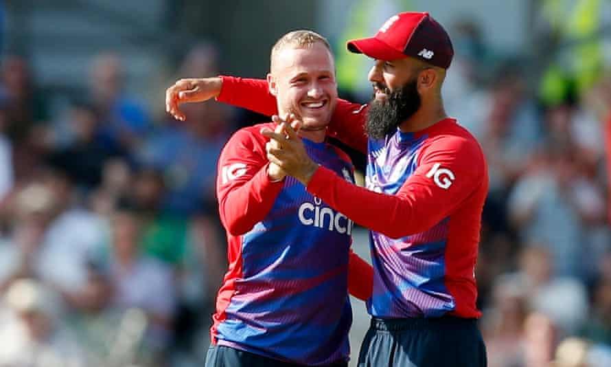 Matt Parkinson celebrates with Moeen Ali after taking the wicket of Pakistan's Azam Khan at Headingley.
