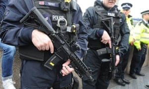 Armed police at the City Hall vigil for the victims of the London Bridge attack.