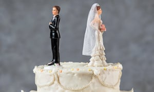 Figures of couples on a wedding cake