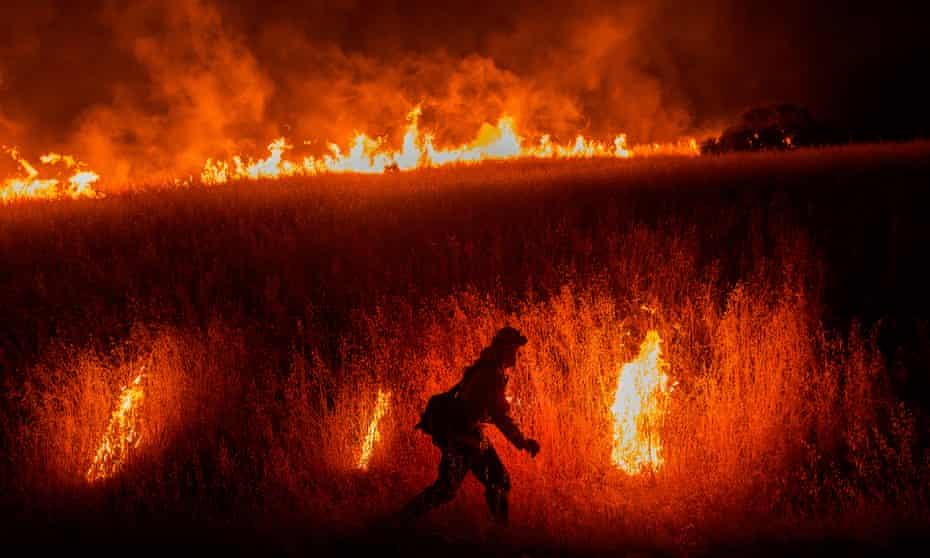 A firefighter battle the Quail Fire near Winters, California on 6 June 2020.