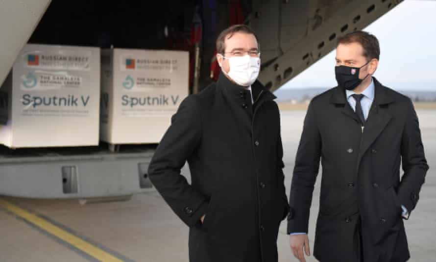 Former Slovak prime minister Igor Matovič, right, and health minister Marek Krajci at Kosice airportas Russia's Sputnik V coronavirus vaccine arrives.