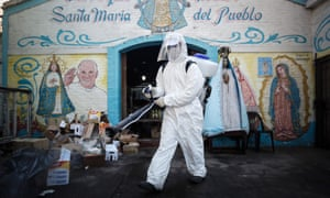 A man performs disinfection tasks in front of the Santa Maria Madre del Pueblo Parish, in Buenos Aires, Argentina, 19 May 2020.