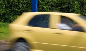 Yellow car passing speed camera