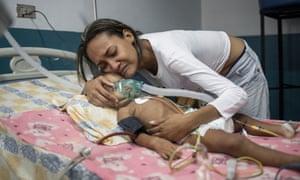 María Baeza hugs her daughter, Luciannys Rivas.