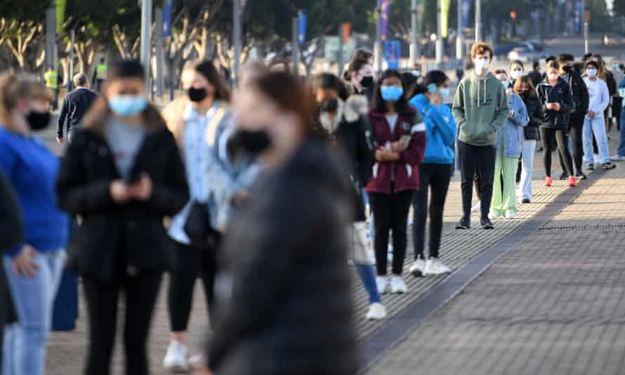 Thousands of HSC students line up to get their Pfizer vaccinations at Qudos arena in Sydney in August
