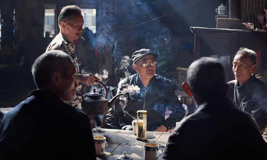 A group of old men gather to smoke, drink jasmine tea and indulge in the popular Sichuan pastime of bǎi lóng mén zhèn (gossiping), China