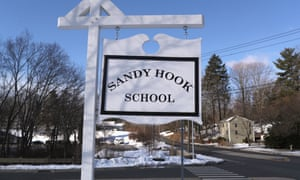 A sign stands near the site of the December 2012 Sandy Hook school shooting in Connecticut.