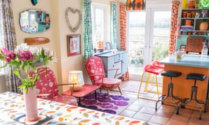 Varied bright colours in the dining to kitchen area with patio doors at the end
