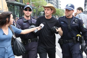 Former Greens senator Scott Ludlam is arrested at an Extinction Rebellion protest in Sydney on 7 October. His bail conditions prevent him from coming within 2km of the Sydney CBD.