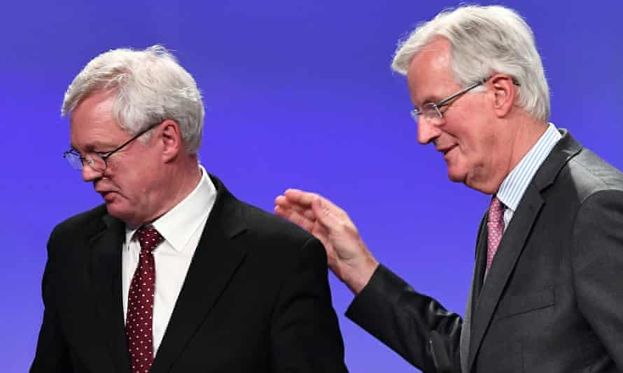 Michel Barnier guides David Davis into the press conference after the latest round of Brexit negotiations.