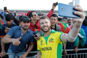 Australia's David Warner takes a selfie with fans.