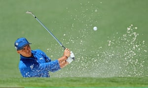 Rickie Fowler plays a shot from a bunker on the second.