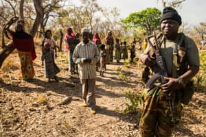A representative of the Central African government accompanies the visit to civilians who were forced from their homes by vicious fighting and into Chinko.