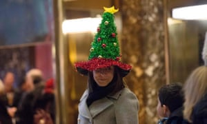 A woman wears a Christmas tree hat in the lobby of Trump Tower, New York.
