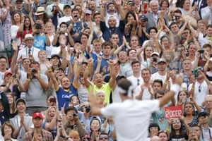 The crowd on Centre Court applaud Roger Federer after his win.