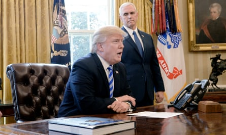 Mike Pence watches Donald Trump at work in the Oval Office.