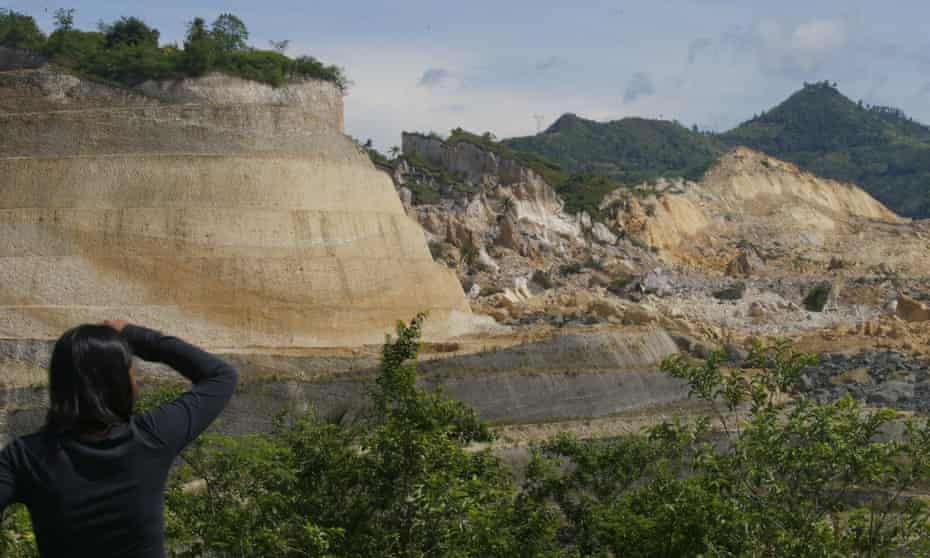 A villager looks at the extent of damage following the landslide in Naga, central Philippines