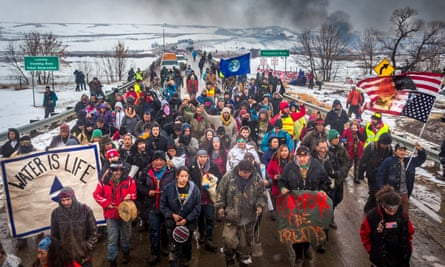 Dakota Access Pipeline water protectors march in South Dakota.