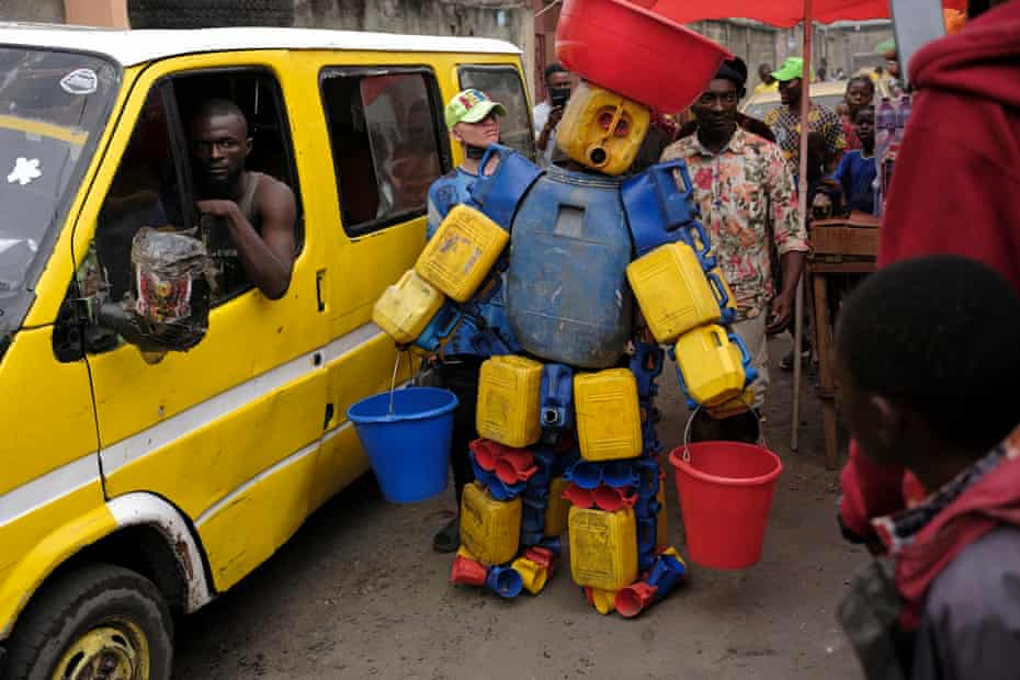 Artist Lioyolo in his costume Maza Mpasi or Difficult Drinking Water created to draw attention to the lack of clean potable water in the capital Kinshasa.