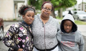 Kozette Green, center, and her twins Jerzey and Josh, nine. 'My kids probably wouldn't get as much as they do now. I think it's horrible.'