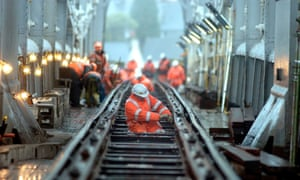 Maintenance workers on the Royal Albert Bridge at Saltash, Cornwall