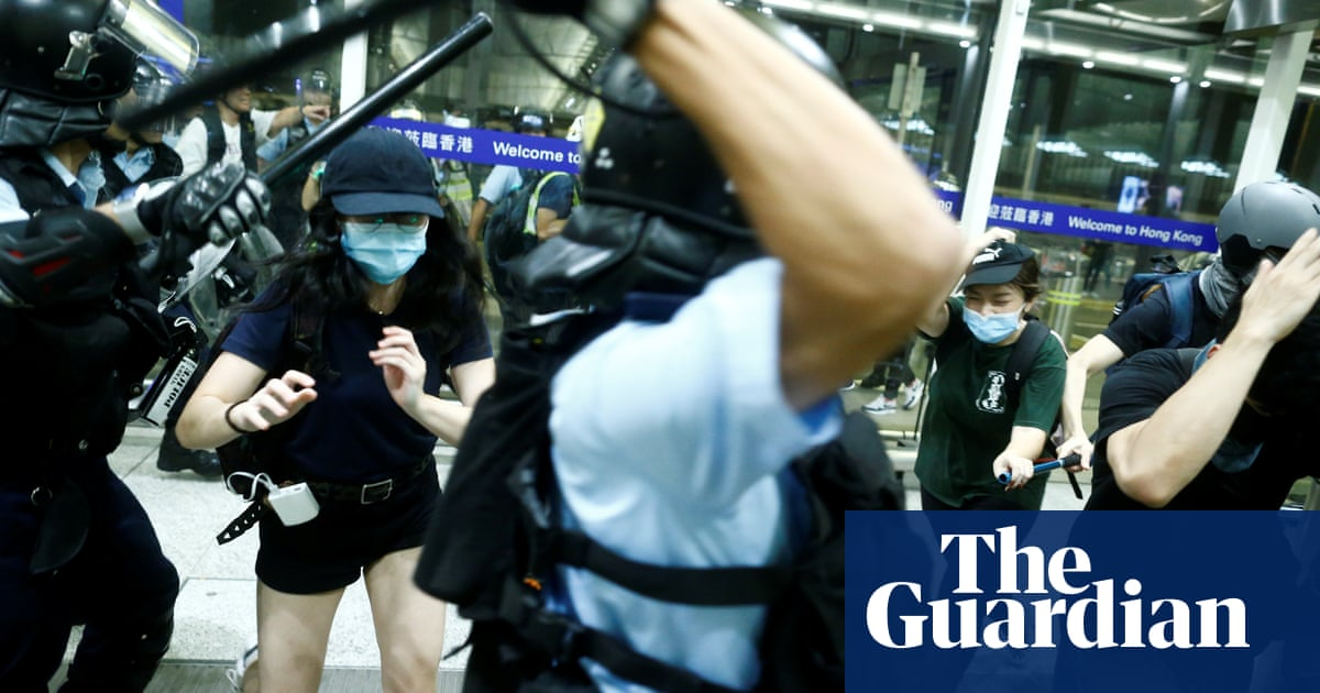 Hong Kong riot police clash with airport protesters