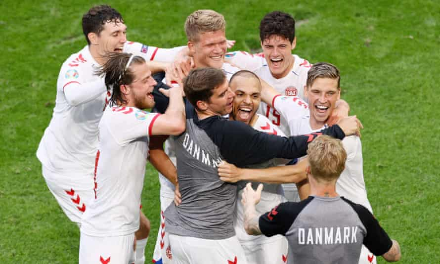 Denmark's players celebrate after beating Wales to reach the Euro 2020 quarter-finals.