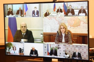 Russia's prime minister, Mikhail Mishustin, and his deputy, Tatiana Golikova, on screen in a virtual meeting with Vladimir Putin.
