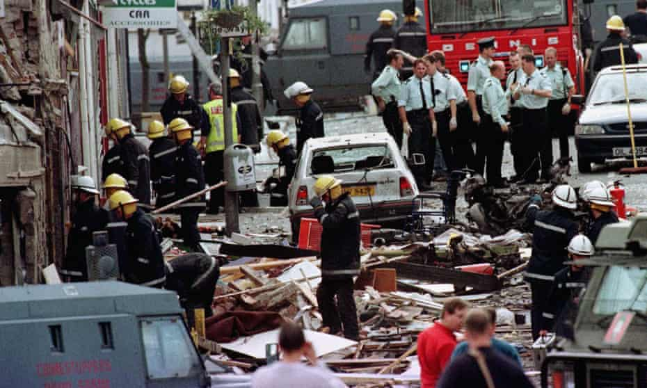 Police and fire brigade inspect blast damage on Market Street, Omagh
