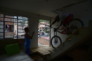 A downhill rider competes during the Adrenalina Urban Bike race final