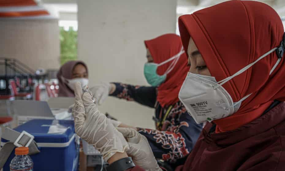 Vaccines doses being prepared in Indonesia.