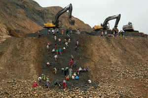 Freelance jade miners collect jade stones in an earth dump of a companies' mining field in Hpakant area, Kachin State, Northern Myanmar.