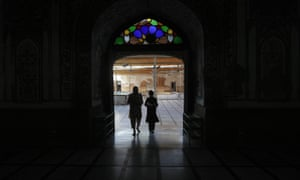 A Pakistani Muslim student and a teacher enter a madrassa, or religious school in Peshawar, Pakistan, Tuesday, May 17, 2016. The religious schools, most of them in mosques, are the only source of education for thousands of Pakistani children. (AP Photo/Mohammad Sajjad)