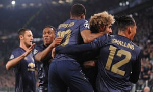 Manchester United celebrates its late winner as they have caused a rare home defeat at Juventus.