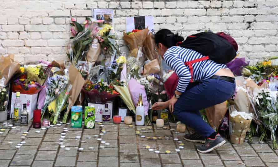Flowers and tributes left at the scene in Hackney where an 18-year-old was stabbed to death