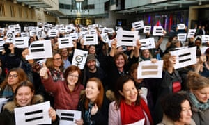BBC employees gather outside Broadcasting House in London, to highlight equal pay on International Women's Day