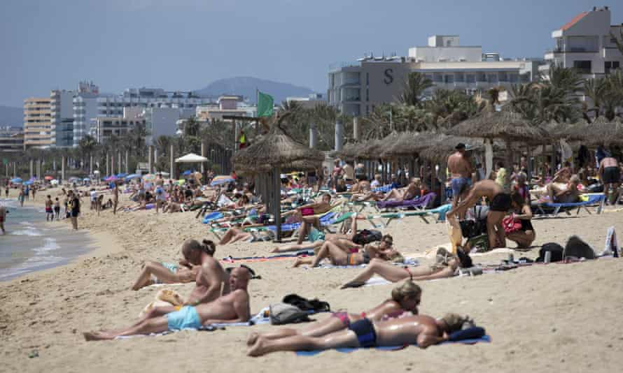 People on a beach in Mallorca this month
