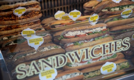 Sandwiches pictured through the shop window