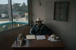 Enrique Aran Blanco, president for more than 20 years of the fishermen co-operative of Saladero, sits in his office in front of a sword that was given symbolically by a lawyer working along them against BP, and beside skulls of a dolphin and a tortoise found dead at the beach about five years after the oil spill.