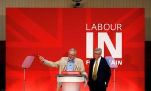 Jeremy Corbyn (left) taking questions after his speech, alongside Alan Johnson