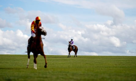 Runners at Newmarket ease down after finishing in the British Stallion Studs Fillies' Handicap at Newmarket on Thursday.