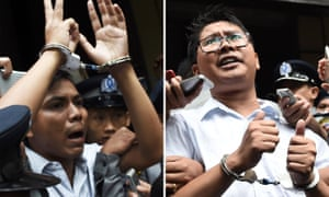 Journalists Kyaw Soe Oo (left) and Wa Lone are escorted by police after their sentencing by a court to jail in Yangon in September